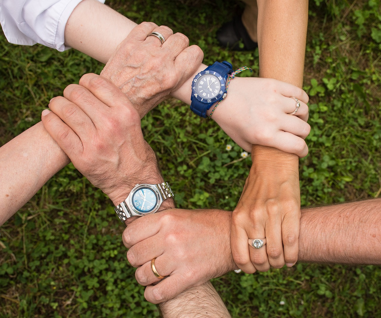 hands holding one another family support addiction treatment